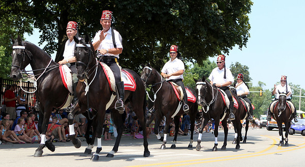 Mike Greene - mgreene@shawmedia.com Members of the Medinah Black Horse Troop wave to the crowd during the Annual Independence Day Parade Sunday, July 1, 2012 in Crystal Lake. Over 100 different groups participated in the parade from City Hall to the Lakeside Festival.