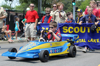 Mike Greene - mgreene@shawmedia.com Jacob Mortz leads Cub Scout Pack 127 of Crystal Lake during the Annual Independence Day Parade Sunday, July 1, 2012 in Crystal Lake. Over 100 different groups participated in the parade from City Hall to the Lakeside Festival.