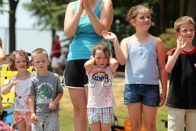 Mike Greene - mgreene@shawmedia.com Rosaline Harhen, 5 of Marengo, covers her ears as fire engine drive by with their sirens while watching the parade with siblings and cousins during the Annual Independence Day Parade Sunday, July 1, 2012 in Crystal Lake. Over 100 different groups participated in the parade from City Hall to the Lakeside Festival.