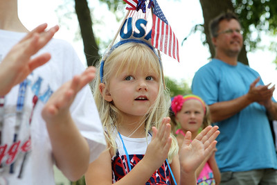 Mike Greene - mgreene@shawmedia.com Carrie Sosnowski, 5 of Crystal Lake, claps for the color guard presentation during the Annual Independence Day Parade Sunday, July 1, 2012 in Crystal Lake. Over 100 different groups participated in the parade from City Hall to the Lakeside Festival.