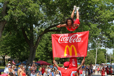 Mike Greene - mgreene@shawmedia.com A member of the Jesse White Tumblers performs as the crowd watches on during the Annual Independence Day Parade Sunday, July 1, 2012 in Crystal Lake. Over 100 different groups participated in the parade from City Hall to the Lakeside Festival.