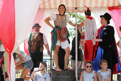 Mike Greene - mgreene@shawmedia.com Cast members of The Fantasticks and supporters of the Raue Center relax on their float during the Annual Independence Day Parade Sunday, July 1, 2012 in Crystal Lake. Over 100 different groups participated in the parade from City Hall to the Lakeside Festival.