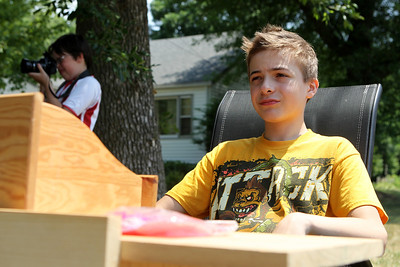 Mike Greene - mgreene@shawmedia.com Riley Freese, 13 of Crystal Lake, waits for customers while selling popsicles during the Annual Independence Day Parade Sunday, July 1, 2012 in Crystal Lake. Over 100 different groups participated in the parade from City Hall to the Lakeside Festival.