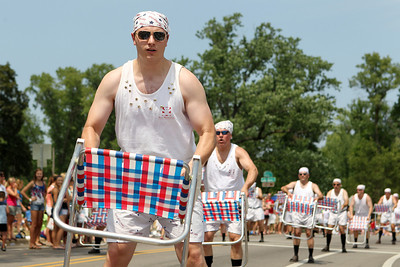 Mike Greene - mgreene@shawmedia.com Aaron Holbrook, of Huntley, and the Lawn Chair Dads perform during the Annual Independence Day Parade Sunday, July 1, 2012 in Crystal Lake. Over 100 different groups participated in the parade from City Hall to the Lakeside Festival.