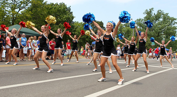 Mike Greene - mgreene@shawmedia.com Members of the Crystal Lake Central Poms team perform during the Annual Independence Day Parade Sunday, July 1, 2012 in Crystal Lake. Over 100 different groups participated in the parade from City Hall to the Lakeside Festival.