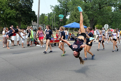 Mike Greene - mgreene@shawmedia.com Members of Crystal Lake Gymnastics Training Center perform during the Annual Independence Day Parade Sunday, July 1, 2012 in Crystal Lake. Over 100 different groups participated in the parade from City Hall to the Lakeside Festival.