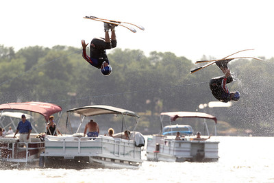Mike Greene - mgreene@shawmedia.com Dan Hansen (left) and Jayson Rishling do front flips off a jump while performing with members of the Wonder Lake Ski Show Team during an Independence Day Show Wednesday, July 4, 2012 at Center Beach in Wonder Lake.