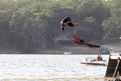 Mike Greene - mgreene@shawmedia.com Jayson Rishling, of Wonder Lake, does a long-dirve off a jump while performing with members of the Wonder Lake Ski Show Team during an Independence Day Show Wednesday, July 4, 2012 at Center Beach in Wonder Lake.