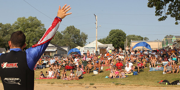 Mike Greene - mgreene@shawmedia.com A group of onlookers watch the Wonder Lake Ski Show Team perform during an Independence Day Show Wednesday, July 4, 2012 at Center Beach in Wonder Lake.