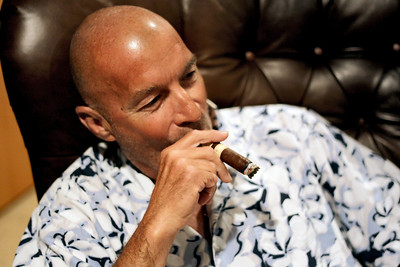 Sarah Nader - snader@shawmedia.com Billy McCaffrey of Waukegan enjoys a cigar while at Kenny the King Tobacco in Lakemoor on Tuesday, July 10, 2012. The Food and Drug Administration has expressed intentions to regulate cigars under a 2009 law that gave them authority over the tobacco industry.