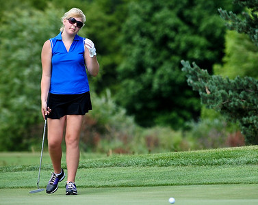Josh Peckler - Jpeckler@shawmedia.com Emily Johnson of McHenry reacts to a bad put during the McHenry County Junior Golf Association's Billy Vahldieck McHenry County Junior Amateur tournament at Boone Creek Golf Club in Bull Valley Tuesday, July 10, 2012.
