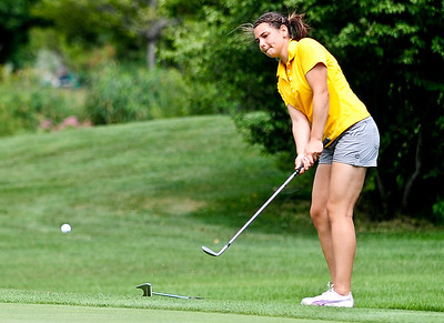 Josh Peckler - Jpeckler@shawmedia.com Amalia Emma of Cary chips her ball onto the green during the McHenry County Junior Golf Association's Billy Vahldieck McHenry County Junior Amateur tournament at Boone Creek Golf Club in Bull Valley Tuesday, July 10, 2012.