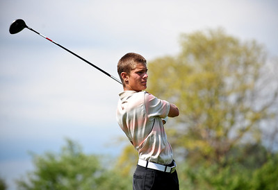 Josh Peckler - Jpeckler@shawmedia.com Austin Wiggerman of Lake in the Hills tees  off from the 4th hole during the McHenry County Junior Golf Association's Billy Vahldieck McHenry County Junior Amateur tournament at Boone Creek Golf Club in Bull Valley Tuesday, July 10, 2012.