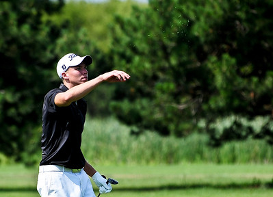 Josh Peckler - Jpeckler@shawmedia.com Anthony Cardelli of Algonquin throws grass in the air to check wind direction during the McHenry County Junior Golf Association's Billy Vahldieck McHenry County Junior Amateur tournament at Boone Creek Golf Club in Bull Valley Tuesday, July 10, 2012.