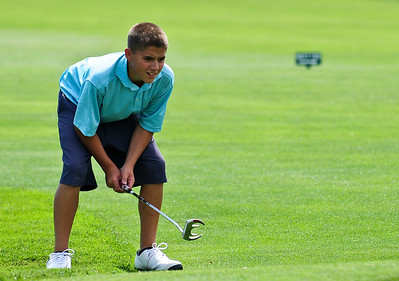 Josh Peckler - Jpeckler@shawmedia.com Jack Mcneill checks the slope of the green prior to putting during the McHenry County Junior Golf Association's Billy Vahldieck McHenry County Junior Amateur tournament at Boone Creek Golf Club in Bull Valley Tuesday, July 10, 2012.