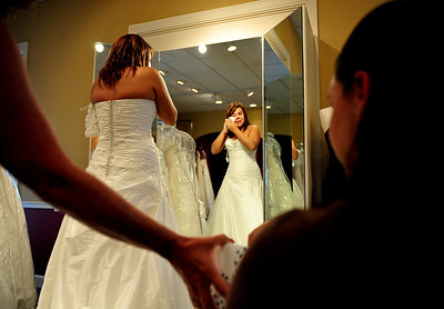 Josh Peckler - Jpeckler@shawmedia.com Malissa Pagan of Chicago wipes away tears while trying on wedding dresses at Kathryn's Bridal in McHenry Wednesday, July 11, 2012. Pagan was trying on dresses as part of the Brides Across America program that gives brides of military members free wedding dresses.