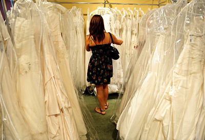 Josh Peckler - Jpeckler@shawmedia.com Malissa Pagan of Chicago looks at wedding dresses at Kathryn's Bridal in McHenry Wednesday, July 11, 2012. Pagan was trying on dresses as part of the Brides Across America program that gives brides of military members free wedding dresses.