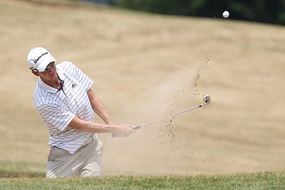 Mike Greene - mgreene@shawmedia.com Griffin Bauman hits out of a sand trap on the 18th during the McHenry County Men's Amatuer Golf Tournament Thursday, July 12, 2012 at Crystal Woods Golf Club in Woodstock.