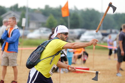 "Mike Greene - mgreene@shawmedia.com Mike Murphy, of Wheaton, practices throwing a hatchet prior to the start of the Rundezvous Race Saturday, July 14, 2012 at Lippold Park in Crystal Lake. The event, billed as a ""frontier survival race,"" was delayed due to inclemate weather but continued after the storms passed."
