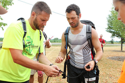 "Mike Greene - mgreene@shawmedia.com Race creator Fred Kaiser (left) reviews knots made by Kevin Wensick, of Oakwood Hills, during the first portion of the Rundezvous Race Saturday, July 14, 2012 at Lippold Park in Crystal Lake. The event, billed as a ""frontier survival race,"" took participants on a 5-6 mile race with 14 events including archery, hatchet throwing, logging and more."