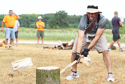 "Mike Greene - mgreene@shawmedia.com Frank Grimaldi, of Elk Grove Village, chops a log in half while competing in the Rundezvous Race Saturday, July 14, 2012 at Lippold Park in Crystal Lake. The event, billed as a ""frontier survival race,"" took participants on a 5-6 mile race with 14 events including archery, hatchet throwing, logging and more."