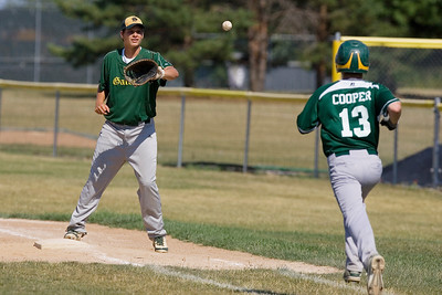 Mike Greene - mgreene@shawmedia.com Crystal Lake South's Max Meitzler looks in a throw after a dropped third strike during the first round of the Phil Lawler Classic Tournament against Waubonsie Valley Monday, July 16, 2012 in Crystal Lake. Crystal Lake South won the game 9-2.