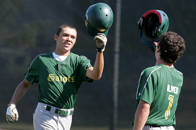 Mike Greene - mgreene@shawmedia.com Crystal Lake South's Jake Bigos celebrates with teammate Casey Oliver after hitting a home run during the first round of the Phil Lawler Classic Tournament against Waubonsie Valley Monday, July 16, 2012 in Crystal Lake. Crystal Lake South won the game 9-2, with Bigos going 4-4 with two doubles and three runs.