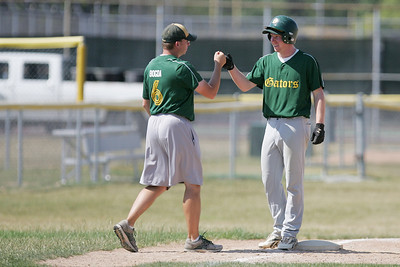 Mike Greene - mgreene@shawmedia.com Crystal Lake South's Troy Bittenbender fist bumps varsity head coach Brian Bogda after hitting a triple during the first round of the Phil Lawler Classic Tournament against Waubonsie Valley Monday, July 16, 2012 in Crystal Lake. Crystal Lake South won the game 9-2.