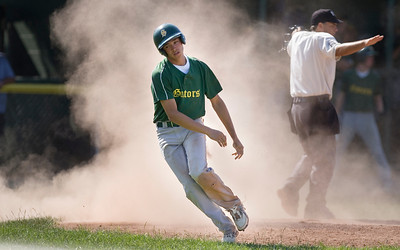 Mike Greene - mgreene@shawmedia.com Crystal Lake South's Jake Bigos comes up in a cloud of dust after scoring a run during the first round of the Phil Lawler Classic Tournament against Waubonsie Valley Monday, July 16, 2012 in Crystal Lake. Crystal Lake South won the game 9-2, with Bigos going 4-4 with two doubles and three runs.