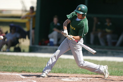 Mike Greene - mgreene@shawmedia.com Crystal Lake South's Jake Bigos swings at a pitch and hits a double during the first round of the Phil Lawler Classic Tournament against Waubonsie Valley Monday, July 16, 2012 in Crystal Lake. Crystal Lake South won the game 9-2, with Bigos going 4-4 with two doubles and three runs.