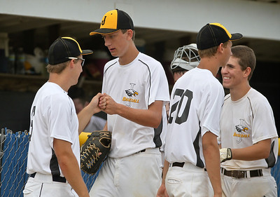 Josh Peckler - Jpeckler@shawmedia.com Jacob's pitcher Nick Ledinsky (center) is congratulated by teammates after ending the 3rd inning on a strike out  against Rolling Meadows during a semi-final game of the Phil Lawler Illinois Baseball Summer State Tournament at Lake Park High School Wednesday, July 18, 2012.