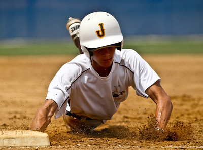 Josh Peckler - Jpeckler@shawmedia.com Jacob's Joe Rizzuto slides headfirst back to first base to avoid being tagged out during a semi-final game of the Phil Lawler Illinois Baseball Summer State Tournament against Rolling Meadows at Lake Park High School Wednesday, July 18, 2012.