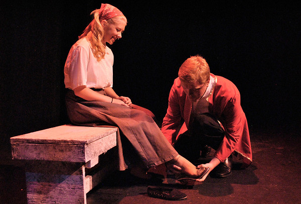 The prince (Bradley Staker, right) fits Cinderella's (Kyra Trynoski) foot with the glass slipper in Cinderella, the last performance in the 2011-2012 Kaneland Community Fine Arts Festival.