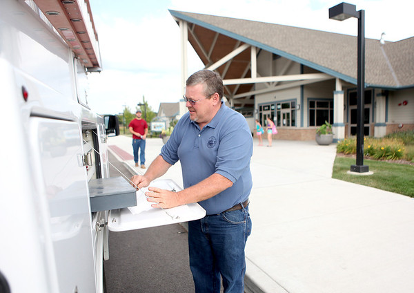 St. Charles Park District Facilities Supervisor Paul Brummel gets something from his truck while working at Otter Cove Tuesday morning. Brummel recently received a perfect score in the National Swimming Pool Foundation's certified pool/spa course offered by the Ohio Aquatic Council.
