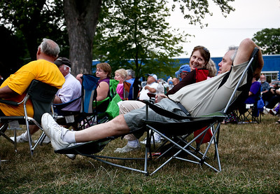 Josh Peckler - Jpeckler@shawmedia.com Bill Coyle of Johnsburg leans back in his chair while talking with wife Mary-Kay during the Fiesta Days Concert in the Park at Veteran's Memorial Park in Mchenry Thursday, July 19, 2012.