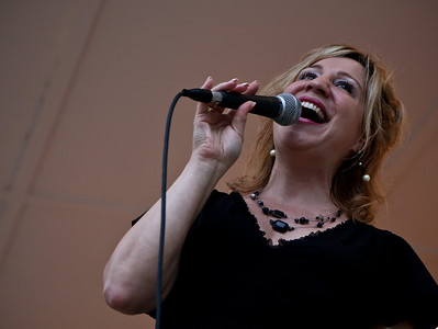 Josh Peckler - Jpeckler@shawmedia.com Maureen Christine of Mchenry sings with the Mchenry City Jazz Band during the Fiesta Days Concert in the Park at Veteran's Memorial Park in Mchenry Thursday, July 19, 2012.