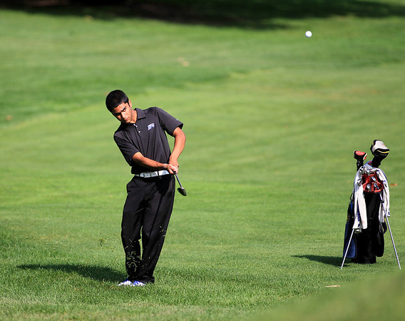 St. Charles North's Raghav Cherala hits onto the green during the final round of the St. Charles Junior Tournament at Pottawatomie Golf Course Thursday.