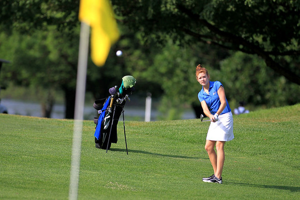 St. Charles North's Jessica Grill hits onto the green during the final round of the St. Charles Junior Tournament at Pottawatomie Golf Course Thursday.