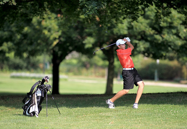 Luke Molloy hits from the fairway during the final round of the St. Charles Junior Tournament at Pottawatomie Golf Course Thursday.