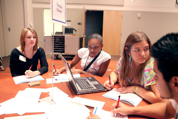 (From left) Kaileigh Jung of Sugar Grove, Tonisha Taylor of Aurora, Cassie Kackert of Oswego and Isaiah Rosas of Batavia work on a project together during an orientation session for new students at Waubonsee Community College in Sugar Grove Tuesday.