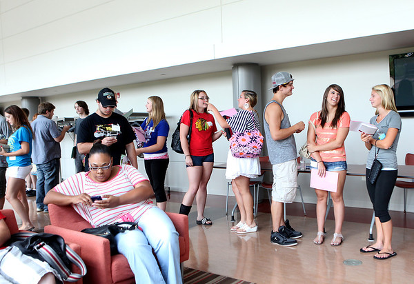 Incoming students wait for their next session during an orientation for new students at Waubonsee Community College in Sugar Grove Tuesday.