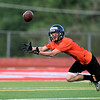 Matt Allen of St. Charles East reaches for a pass during a 7-on-7 football challenge featuring Geneva, St. Charles East, St. Charles North and Batavia at Mooseheart Friday night.