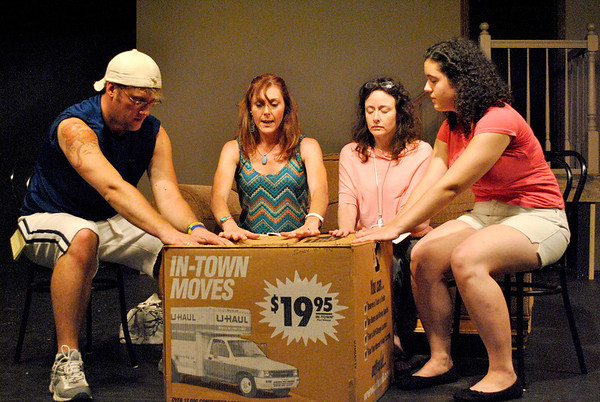 "Andrew (left, played by J.P. Quirk of South Elgin), Felicia (center-left, Shelly Rolf of Geneva), Lillian (center-right, Lori Rohr of Palatine), and Deirdre (right, Katy Steele of Aurora) attempt a seance during a rehearsal of the Albright Theatre's production of ""I Hate Hamlet""."