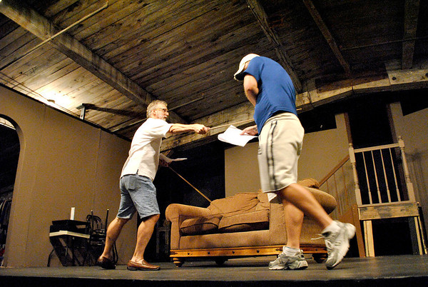 """Barrymore (left, played by Rich Jacob of North Aurora) coerces Andrew (J.P. Quirk of South Elgin) into a duel during a rehearsal of the Albright Theatre's production of """"I Hate Hamlet""""."""