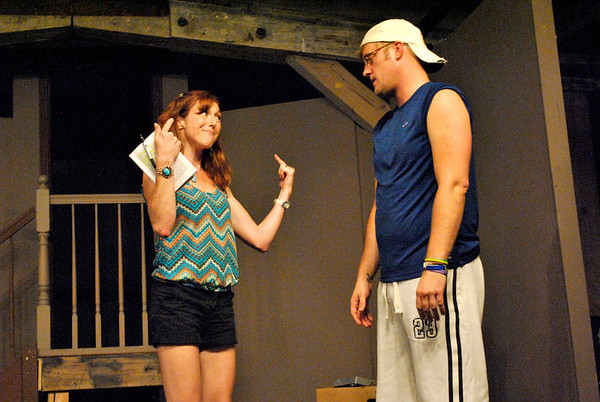 """Felicia (left, played by Shelly Rolf of Geneva) tells her client Andrew (right, played by J.P. Quirk of South Elgin) to be more positive about his new living space during a rehearsal of the Albright Theatre's production of """"I Hate Hamlet""""."""