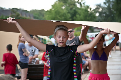 Josh Peckler - Jpeckler@shawmedia.com Alyssa Kirkpatrick, 13 of Algonquin carries a piece of cardboard on her head during the Algonquin Founders' Days Cardboard Boat Regatta in Algonquin Thursday, July 26, 2012.