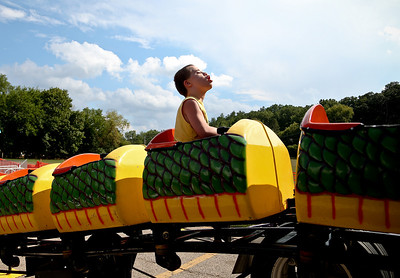 Josh Peckler - Jpeckler@shawmedia.com Jordan Janus, 12 of Carpentersville rides on the Dragon Wagon during the special needs carnival at the Algonquin Founders' Days held at Towne Park in Algonquin Thursday, July 26, 2012.