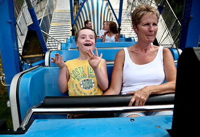 Josh Peckler - Jpeckler@shawmedia.com Jordan Janus, 12 of Carpentersville smiles with his mother Shellise as they ride on Pharaoh's Fury for special needs day at the Algonquin Founders' Days held at Towne Park in Algonquin Thursday, July 26, 2012.