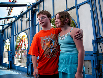 Josh Peckler - Jpeckler@shawmedia.com Zach Lenart, 17 of Woodstock puts his arm around Elizabeth Proctor, 9 of Carpentersville as they look into a mirror inside a funny house during the special needs carnival at the Algonquin Founders' Days held at Towne Park in Algonquin Thursday, July 26, 2012.