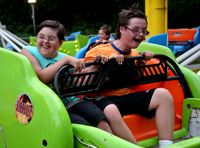 Josh Peckler - Jpeckler@shawmedia.com Ethan Newett, 11 and Nathaniel Raica, 13 both of Algonquin smile as they ride on the Sizzler during the special needs carnival at the Algonquin Founders' Days held at Towne Park in Algonquin Thursday, July 26, 2012.